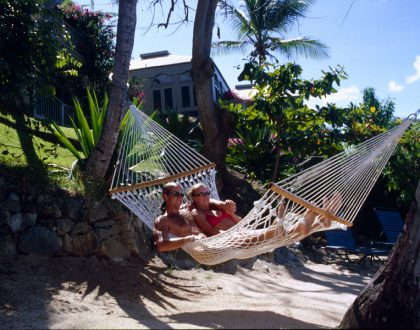 couple in hammock on the beach